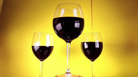 Red wine glass glasses yellow background Footage