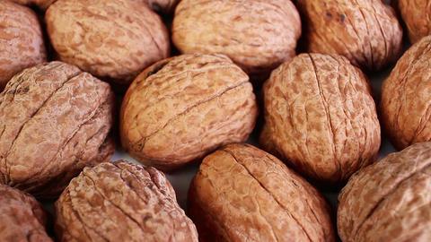 Walnut shell walnuts shells rotating texture pattern closeup footage Live Action