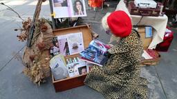 Taiwanese girl reading magazine in street market Footage