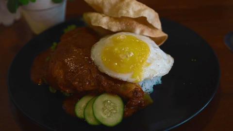close pan of nasi lemak malaysian food dish Footage