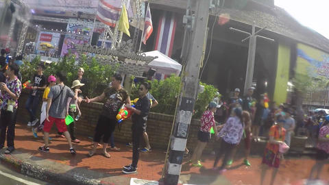 songkran festival motorbike view past crowd - slow motion Footage