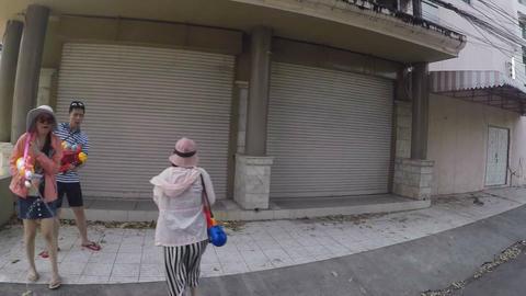 water gun chasing down chinese tourists - songkran Footage