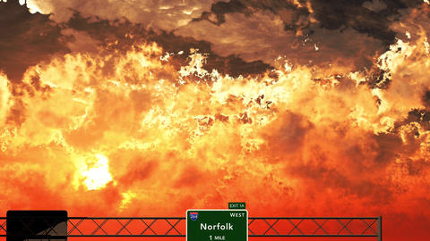 4K Passing Norfolk USA Interstate Highway Sign in the Sunset Animation