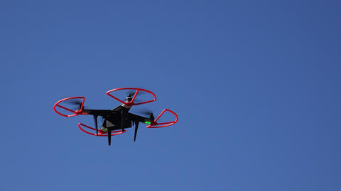 Quadrocopters, drone flying in the sky. 4K Footage