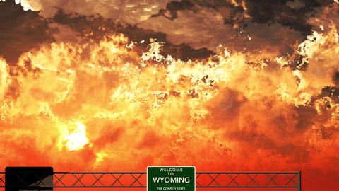 4K Passing Welcome to Wyoming USA Interstate Highway Sign in the Sunset Animation