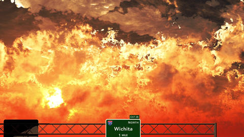 4K Passing Wichita USA Interstate Highway Sign in the Sunset Animation