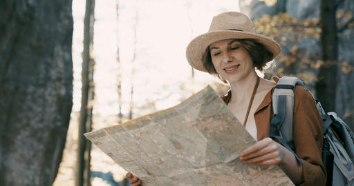 Close up Attractive young woman in stylish hat and a tourist map in her hands Live Action