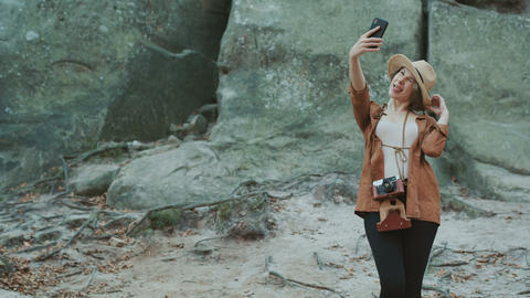 Traveler girl take a selfie portrait with rocks,... Stock Video Footage
