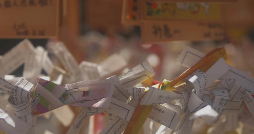 Many oracles at Asakusa shrine mild wind close up slow focus in Live Action