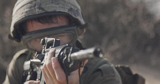 Close up of an Israeli soldier poiting his rifle looking for enemies GIF