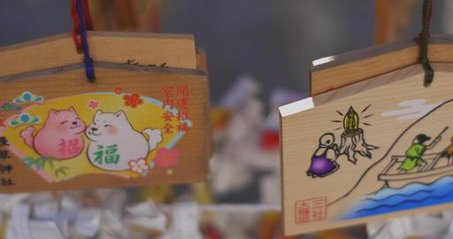 Votive tablets at Asakusa shrine close shot low angle left tracking shot Live Action