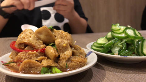 Motion of people eating appetizers on table inside Chinese restaurant with 4k Live Action