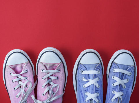 two pairs of worn textile sneakers with white laces Photo