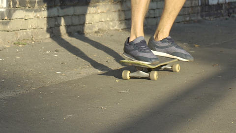Male student in sneakers skateboarding in park after lessons, healthy lifestyle Footage