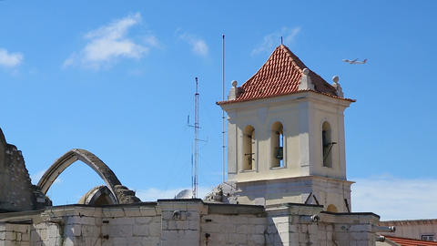 Airplane flying high in sky over ruins of church, sightseeing tour, travel Live Action