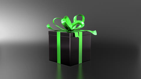 Elegant black gift box with ribbon opening GIF