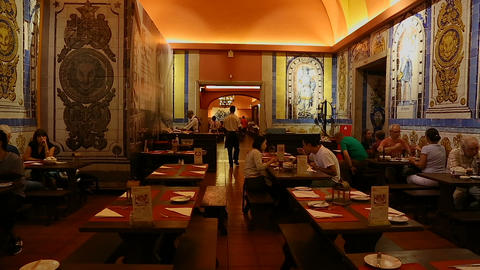 LISBON, PORTUGAL - CIRCA AUGUST 2014: People in the city. People dining in Live Action