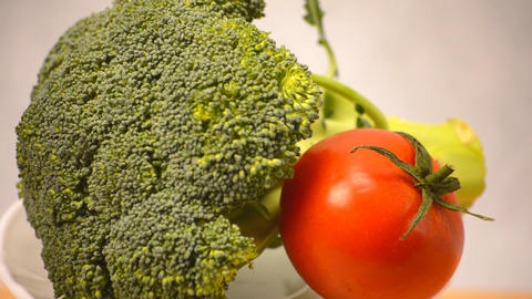 Broccoli and Tomato on Display GIF