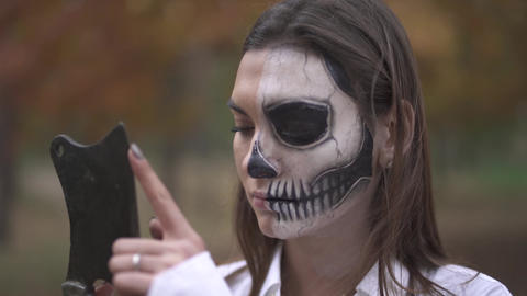 Halloween. Woman with a scary Halloween makeup Footage