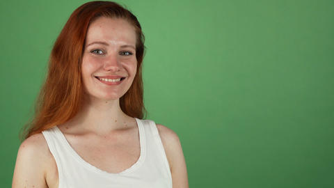 Gorgeous red haired woman smiling presenting copy space Footage