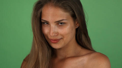 Studio shot of a stunning young happy woman smiling to the camera Live Action