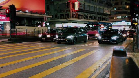Hong kong night street crossroad people traffic Footage