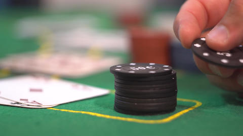 Gambler Playing with Poker Chip GIF