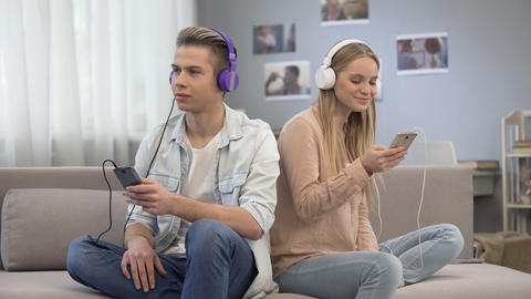 Teenagers synchronizing their playlists, sharing their interests to each other Live Action