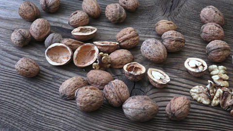 Walnuts in a basket on a wooden background GIF