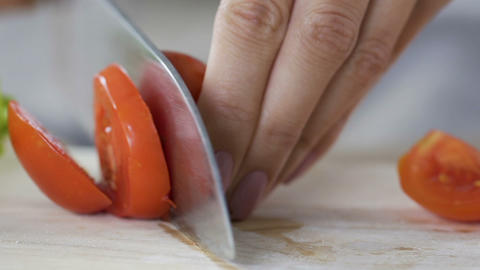 Female hands slicing tomatoes with big knife, macro close-up, health nutrition Live Action
