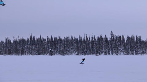 Snowkiting on a Winter Forest Lake Footage