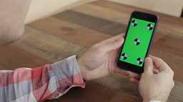 Man Holding Smartphone With Green Touch Screen, Chroma Key For Custom Content.cl Footage