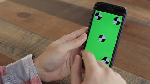 Man Holding Smartphone Touch Screen With Green Screen Chroma Key For Custom Cont stock footage