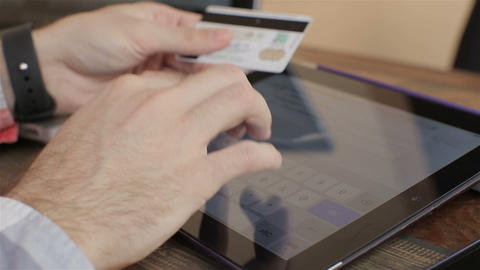 Shopping on-line with credit card on digital tablet.close up Footage