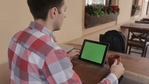 Man Holding tablet Touch Screen With Green Screen Chroma Key For Custom Content. Footage