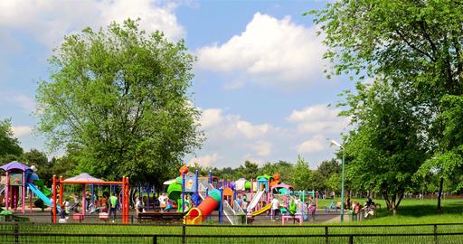 Happy Children Having Fun In Youths Public Park (Tineretului Park) Playground Footage