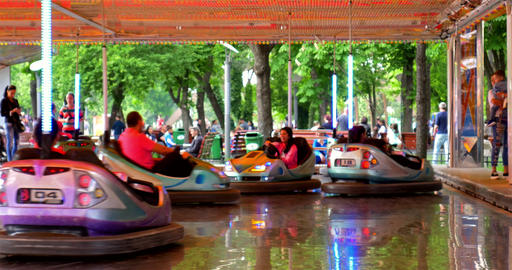 Children And Parents Having Fun On Bumper Cars Ride In Youths Public Park stock footage