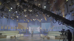 TV Studio with a working crane with a camera . TV show Footage