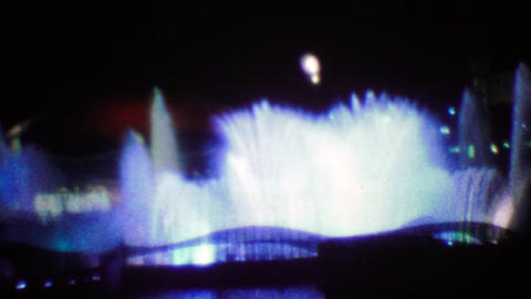 1964: Colorful night time water fountains at EXPO New York World's Fair Footage