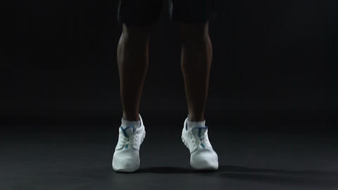Male competitor jumping in ergonomic comfortable sport shoes, intensive activity Footage
