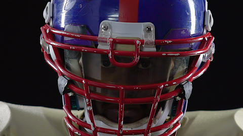 College footballer face in helmet close up, looking strong, american culture Live Action
