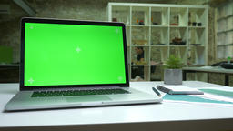 Desolate working space, working computer with green screen switched on, white Footage