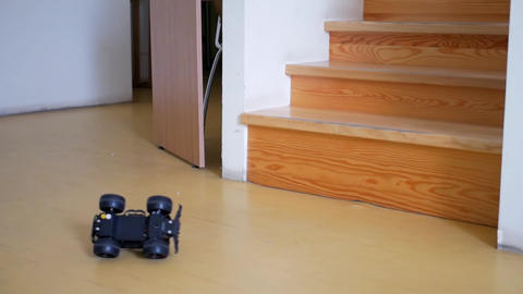 Radio controlled car falls from wooden steps Footage
