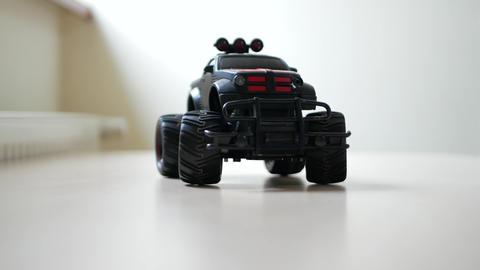 Plastic toy car rides on floor Footage