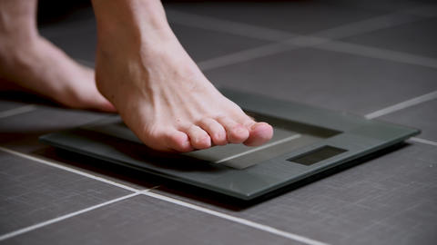 Male feet on glass scales, men's diet, body weight Live Action