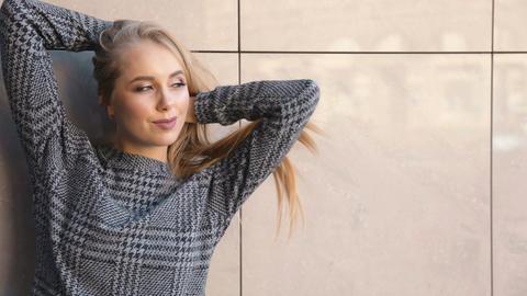 Fashion Woman before Light Wall Footage