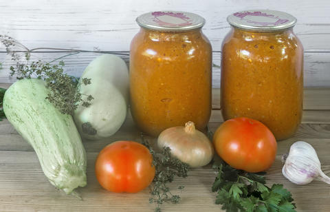 Canned squash caviar with vegetables in glass jars Photo