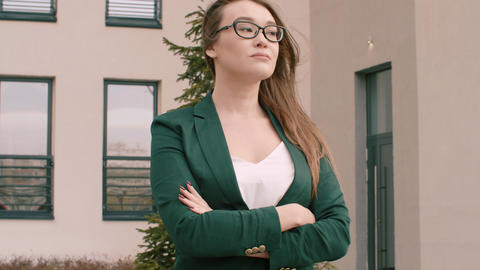 Business woman in glasses and business suit outdoor, business office background Live Action