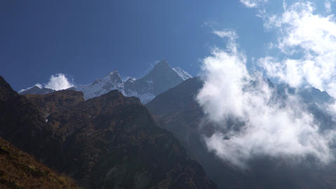 Annapurna region mountain timelapse. Timelapse of clouds around a mountain Live Action
