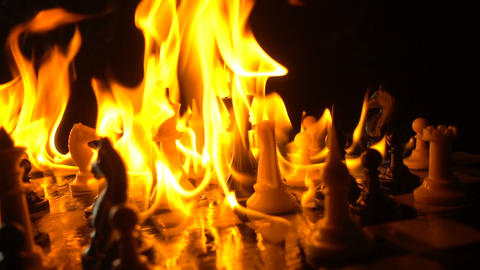 Chess Pieces In Flames Footage